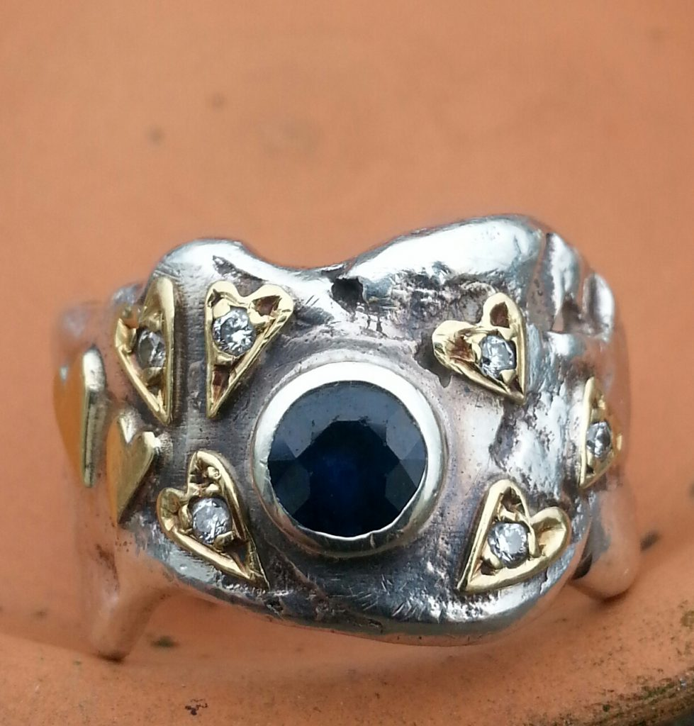 recycled diamond and sapphire ring.